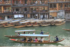 Tourists taking boat at fenghuang ancient town Royalty Free Stock Image