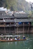 Tourists taking boat at fenghuang ancient town Stock Image