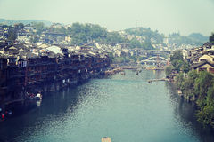 Tourists taking boat at fenghuang ancient town Stock Images