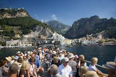 Tourists taking boat to Amalfi, a town in the province of Salerno, in the region of Campania, Italy, on the Gulf of Salerno, 24 mi Stock Photo