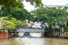 Tourists taking the Cruise Tour Boat to exploring the Malacca River. Malacca has been listed as a UNESCO World Heritage Site 2008. Malacca, Malaysia - July 15 Stock Image