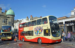 Tourists taking a Double Decker Bus From Brighton Station, UK. Royalty Free Stock Image
