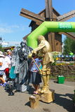 Tourists taking photo with living statues. Velyki Sorochyntsi -August 20, 2016: Tourists taking photo with living statues during Sorochintsy Fair in Velyki stock images