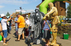 Tourists taking photo with living statues. Velyki Sorochyntsi -August 20, 2016: Tourists taking photo with living statues during Sorochintsy Fair in Velyki stock photos