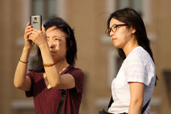 Tourists taking a photo Stock Images