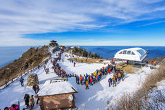 Tourists taking photos of the beautiful scenery and skiing around Deogyusan,South Korea. Royalty Free Stock Image