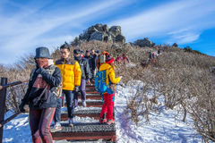 Tourists taking photos of the beautiful scenery and skiing around Deogyusan,South Korea. Stock Photo