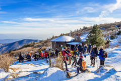 Tourists taking photos of the beautiful scenery and skiing around Deogyusan,South Korea. Royalty Free Stock Photo
