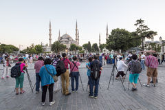 Tourists taking photos of Blue Mosque in Istanbul, Turkey. Istanbul, Turkey - July 1, 2014: Tourists taking photos of Blue Mosque on July 1, 2014. Blue Mosque is Stock Images