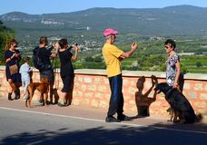 Tourists taking photos in french city. Tourists taking photos at the viewpoint in Roussillon, France Royalty Free Stock Photography