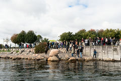 Tourists taking photos of the Little Mermaid statue