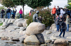 Tourists taking photos of the Little Mermaid statue in Copenhage Royalty Free Stock Photo