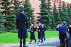 Tourists taking photos of marching soldiers. Guard of Honour change at the Tomb of Unknown soldier, new year trees at background. Taken on May 01, 2013 in Stock Images
