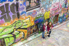 Tourists taking photos with smartphone selfie stick in laneway Stock Photos