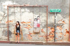 Tourists taking photos with Street Art in Georgetown Stock Photography