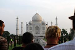 The tourists taking photos of Taj Mahal in a crowd. Taken in Agra, India, August 2018 royalty free stock images