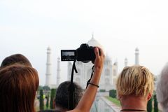 The tourists taking photos of Taj Mahal in a crowd. Taken in Agra, India, August 2018 royalty free stock photos