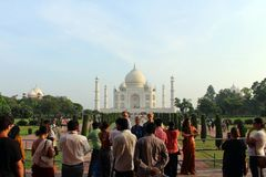The tourists taking photos of Taj Mahal in a crowd. Taken in Agra, India, August 2018 stock photos