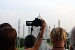 The tourists taking photos of Taj Mahal in a crowd. Taken in Agra, India, August 2018 royalty free stock photography