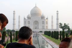 The tourists taking photos of Taj Mahal in a crowd. Taken in Agra, India, August 2018 royalty free stock image