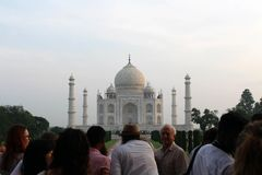 The tourists taking photos of Taj Mahal in a crowd. Taken in Agra, India, August 2018 royalty free stock photo
