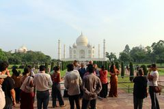 The tourists taking photos of Taj Mahal in a crowd. Taken in Agra, India, August 2018 stock photo