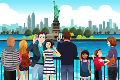 Tourists Taking Picture Near Statue of Liberty. A vector illustration of Tourists Taking Picture Near Statue of Liberty Royalty Free Stock Photos