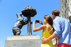 Tourists taking pictures of bear statue in Madrid Royalty Free Stock Image