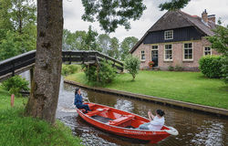 Tourists  taking pictures on a boat in Giethoorn, Netherlands Royalty Free Stock Photo
