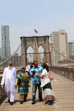 Tourists taking pictures on the Brooklyn Bridge Stock Photo