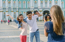 Tourists taking pictures of each other Royalty Free Stock Photography