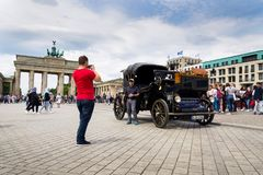 Tourists taking pictures in front of Brandenburger Tor - Brandeburg gate in Berlin, Germany. BERLIN, GERMANY - MAY 15 2018: Tourists taking pictures in front of stock photo