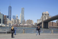 Tourists taking pictures in the front of Brooklyn Bridge Stock Images