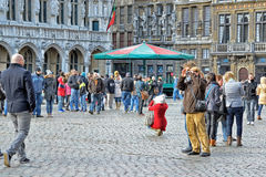Tourists taking pictures on Grand Place Royalty Free Stock Photos