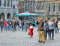 Tourists taking pictures on Grand Place Stock Images