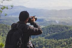 Tourists are taking pictures of nature on the mountain. stock photo