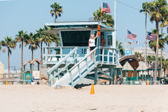 Tourists taking pictures near bay watch tower on Venice beach in California USA Stock Photos