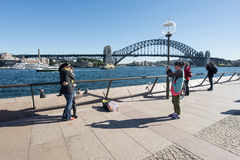 Tourists taking pictures at Opera house Stock Photo