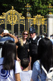 Tourists taking pictures with the policeman Royalty Free Stock Photo