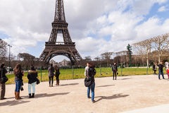 Tourists Taking Pictures and Selfies at Eiffel Tower, Paris France Stock Photo