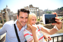 Tourists taking pictures of themselves in Rome. Couple taking picture by the Roman Forum Royalty Free Stock Images