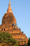 Tourists taking pictures from the top of a temple at Bagan Royalty Free Stock Photo