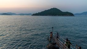 Tourists taking pictures at western swimming shed in the sunset. Hong Kong stock video