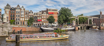 Tourists taking a river cruise in Amsterdam Royalty Free Stock Images
