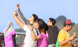 Tourists taking selfie picture. Stock Photo