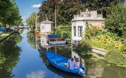 Tourists taking a sightseeing tour in a boat in Edam Stock Photo