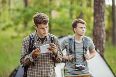 Tourists talk on the radio, and specify your route. Young tourists talk on the radio, and specify your route stock image
