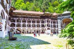 Tourists at the territory of famous Rila Monastery, Bulgaria Stock Photo