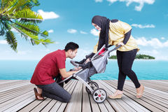 Tourists with their baby on the jetty Stock Photos