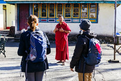 Tourists with Tibetan monk in Tibetan Buddhism Temple with monks in Sikkim, India Royalty Free Stock Photo